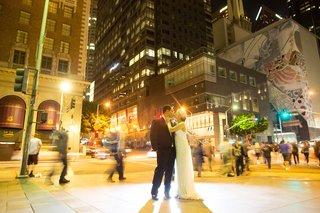 bride-in-a-jenny-packham-dress-kisses-groom-in-black-tuxedo-in-downtown-los-angeles-ca