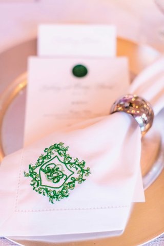 wedding-monogram-embroidered-on-napkin-ring-at-dinner-table-silver-napkin-ring