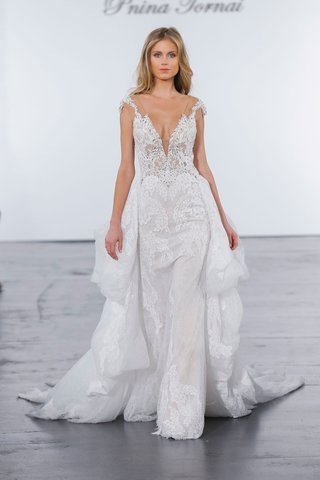 pnina-tornai-for-kleinfeld-2018-wedding-dress-sheer-cap-sleeve-gown-lace-ruffle-skirt-in-back