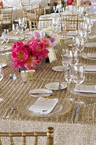 wedding-reception-table-with-gold-sequined-tablecloth-and-white-and-pink-flowers