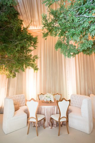 white-tufted-settee-banquette-and-chairs-at-wedding