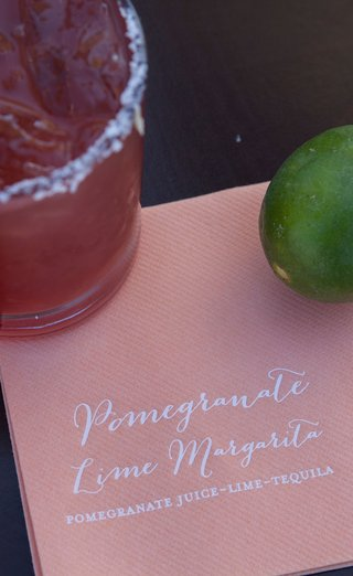 wedding-reception-cocktail-hour-signature-drink-calligraphy-on-cocktail-beverage-napkin-pomegranate