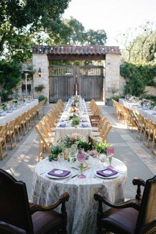 elegant-dark-plum-chairs-at-sweetheart-table-purple-napkins-low-centerpieces-outdoor-wedding