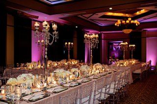 long-tables-covered-in-sequin-linens-in-dark-lighting