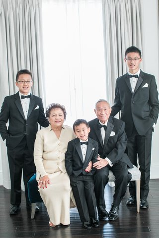 couple-celebrating-50th-anniversary-post-with-their-grandsons