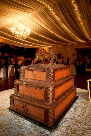 wooden-crate-cake-with-leather-binding-and-horse-sculpture