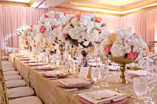 wedding-reception-long-table-gold-linen-high-low-centerpieces-white-blush-peach-coral-rose-orchids