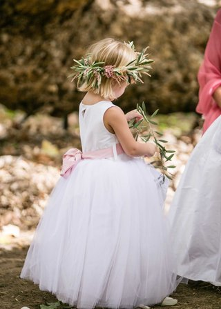 flower-girl-with-pink-bow-sash-flower-crown-of-olive-leaves-and-pink-flowers