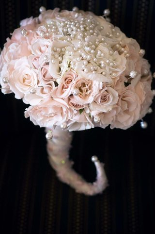 pink-and-white-roses-with-ribbon-wrapped-handle