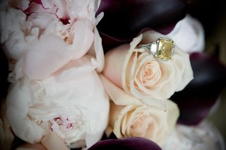 three-stone-diamond-engagement-ring-on-peonies-and-roses