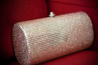 rhinestone-studded-wedding-purse-on-red-couch