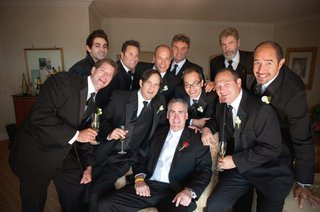 men-in-tuxedos-with-champagne-in-suite