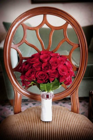 crimson-roses-wrapped-in-white-with-brooch