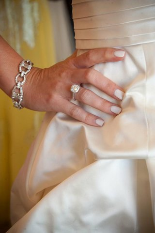 bride-with-white-manicure-engagement-ring-and-diamond-bracelet
