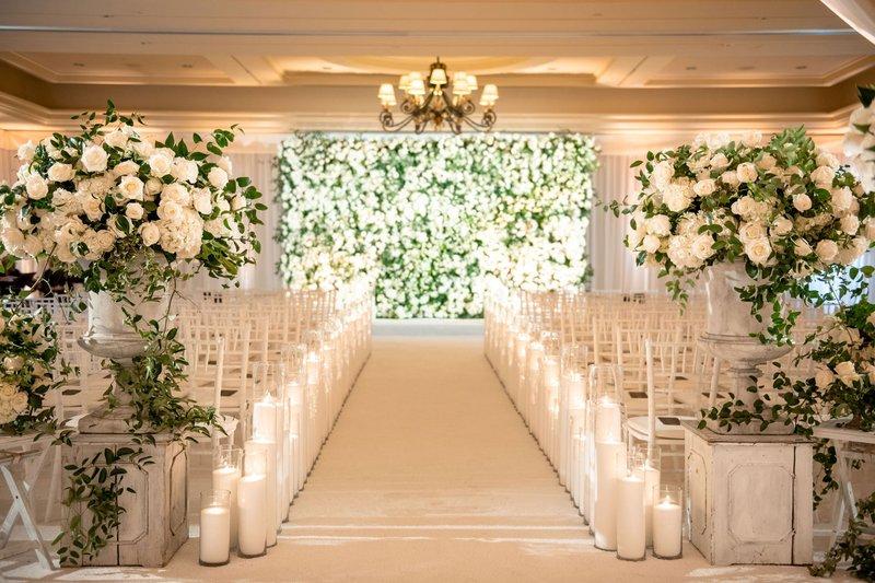 White Rose Arrangements at Ballroom Ceremony