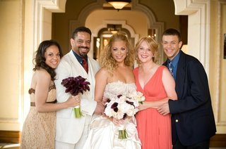 bride-with-mixed-race-family-at-wedding