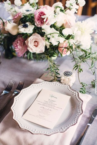 A Charming Fete Place Setting mauve linens and pretty flowers