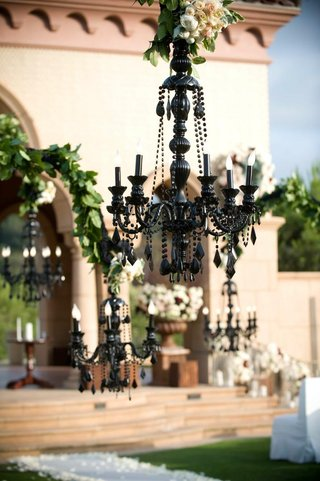 outdoor-wedding-ceremony-with-black-chandeliers-decorations