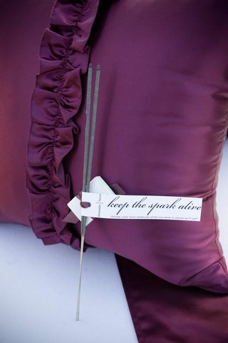 sparklers-on-purple-pillow-with-custom-tag