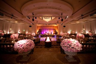 purple-lighting-on-dance-floor-and-pink-flowers