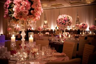 gold-chair-covers-and-blush-roses-in-candelabra