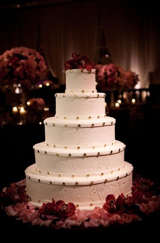 round-wedding-cake-with-orchids-and-gold-dots