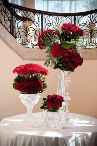red-roses-and-flowers-in-white-vessels