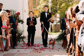 wedding ceremony processional ring bearer tuxedo cowboy hats and walking dog pink orange flowers