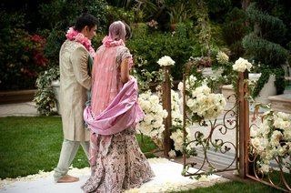 indian-groom-and-bride-walk-barefoot-outside