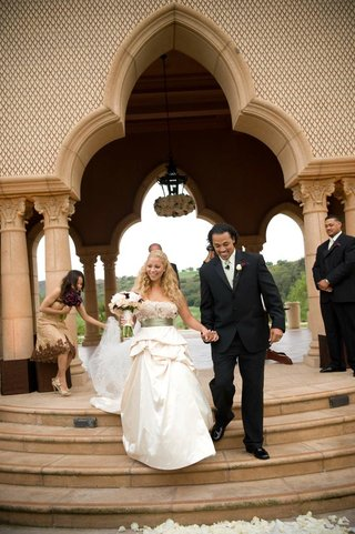 nicholas-barnett-and-bride-walk-down-steps-as-husband-and-wife