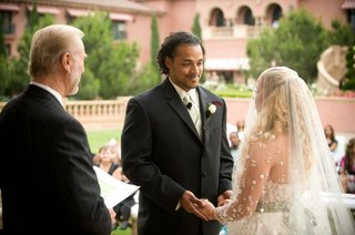 bride-and-nicholas-barnett-at-altar-with-officiant