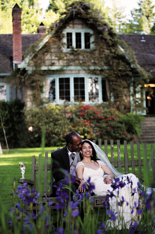bride-in-a-claire-pettibone-lace-gown-and-veil-with-groom-in-black-tails-sit-on-a-bench