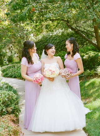 bride-and-two-bridesmaids-wearing-lavender-dresses-with-fluttery-cap-sleeves