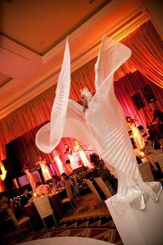 woman-in-white-fan-costume-on-pedestal