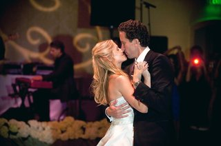 bride-and-groom-embrace-on-wedding-dance-floor