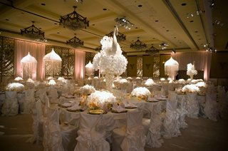 ruffled-white-chair-covers-and-tall-floral-arrangements