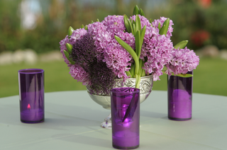 silver-vase-with-purple-flower-centerpiece-and-candles