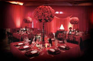 black-chairs-around-square-red-tables