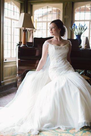 bride-reclining-bateau-neck-wedding-gown-dayton-ohio-ines-di-santo-classic-stylish