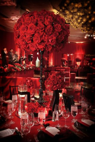 tall-black-candlestick-topped-with-red-roses