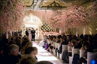 white-ruched-ceremony-chairs-and-pink-trees