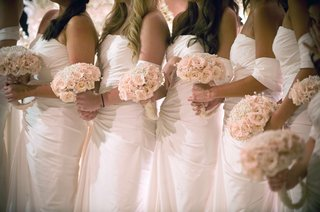 bridesmaids-in-white-dresses-holding-nosegays