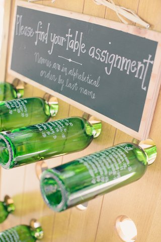 green-wine-bottle-seating-chart-at-wedding