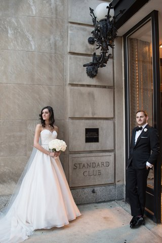 bride-in-essence-of-australia-wedding-dress-groom-in-bonobos-tux-cool-pose-standard-chicago