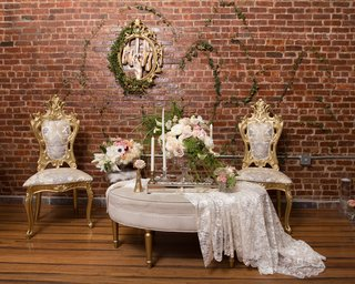 wood-floors-vines-on-brick-wall-vintage-inspired-chairs