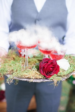 red-cocktails-featuring-dry-ice-steam-on-platter-moss-celtic-wedding