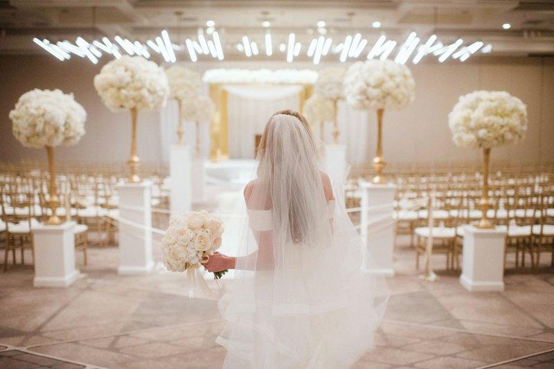 Bride Looking at Ceremony Decor