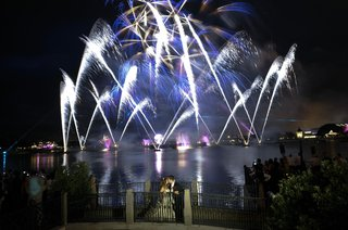 bride-and-groom-in-front-of-disney-world-fireworks