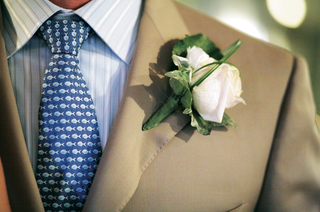 groom-in-khaki-suit-and-blue-fish-tie-with-light-pink-rose-boutonniere