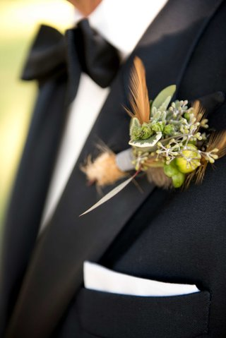 grooms-lapel-decoration-of-small-green-plants-and-branches-with-little-orange-feathers